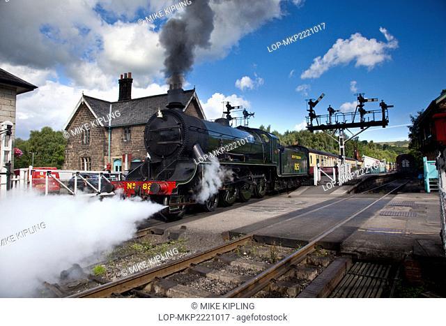 England, North Yorkshire, Grosmont. SR 4-6-0 Class S15 825 Steam Engine leaving Grosmont Station on the North York Moors Historic Railway
