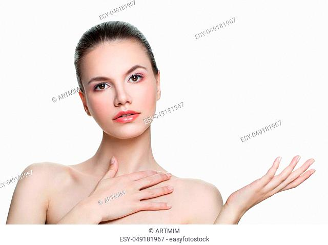 Beautiful spa woman with empty copy space on the open hand isolated on white background. Skincare and wellness concept. Presenting your product