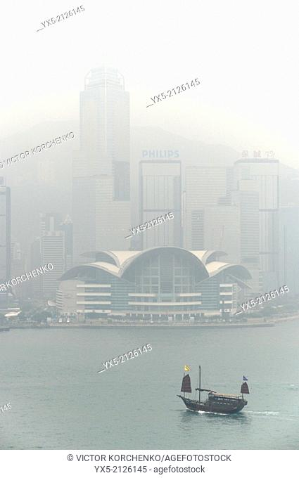 Convention Centre and Victoria harbour in the morning fog, Hong Kong