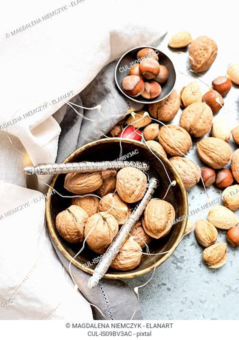 Walnuts and almonds in shell, hazelnuts, ornaments