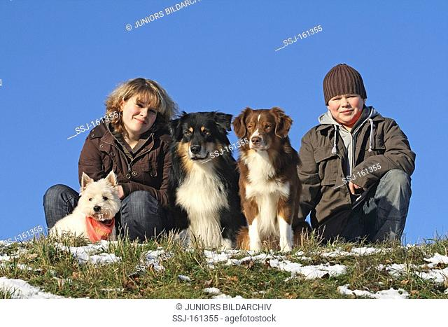 boy and girl with different dogs