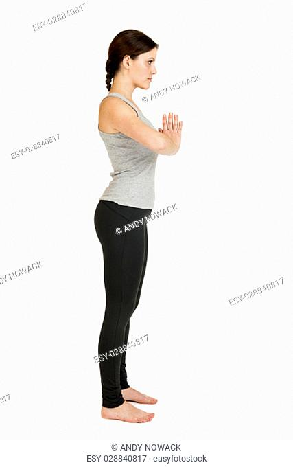 full body view of a young black-haired woman in yoga exercise \
