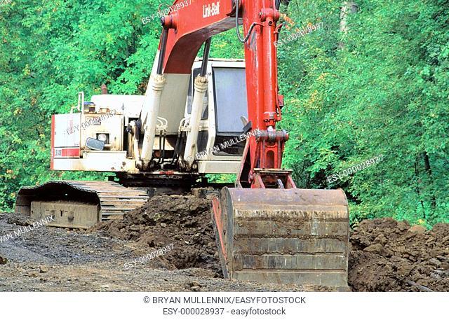 Shovel digging on boundary of refuge. Minto-Brown wildlife refuge. Salem. Oregon. USA
