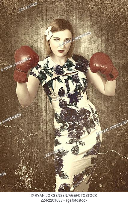 Beautiful vintage boxing pinup girl wearing red gloves when training in an old style personal fitness poster with added texture
