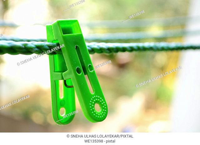 Green Cloth clips on rope ,Poona,Mahareashtra,India