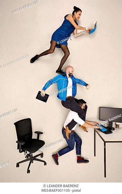 Tthree business colleagues on top of each other