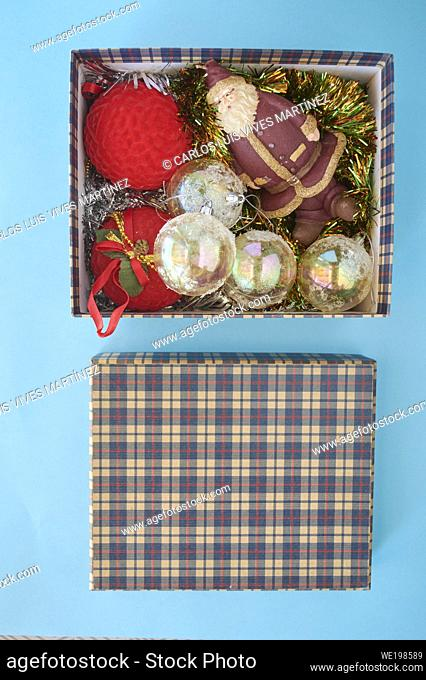 Christmas Decoration In A Box some different christmas ornaments in a box, on a blue background