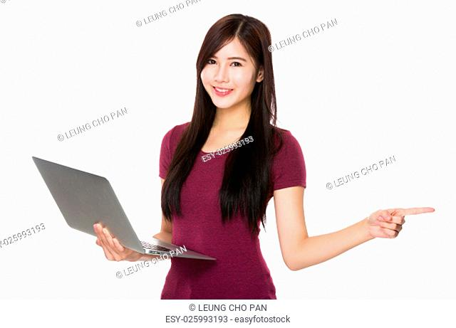 Asian Young Woman hold with computer and finger point aside
