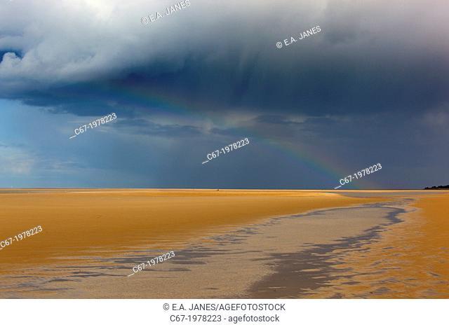 Rainbow over Holkham Bay National Nature Reserve Norfolk UK in April Storms