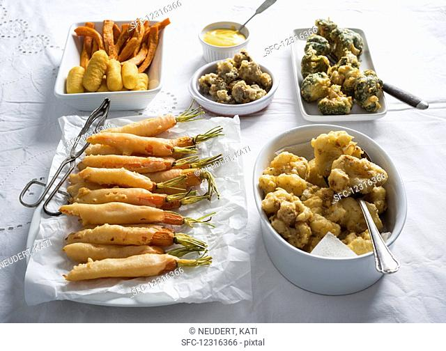 Beer batter vegetables served with croquettes and sweet potato fries with dip (vegan)