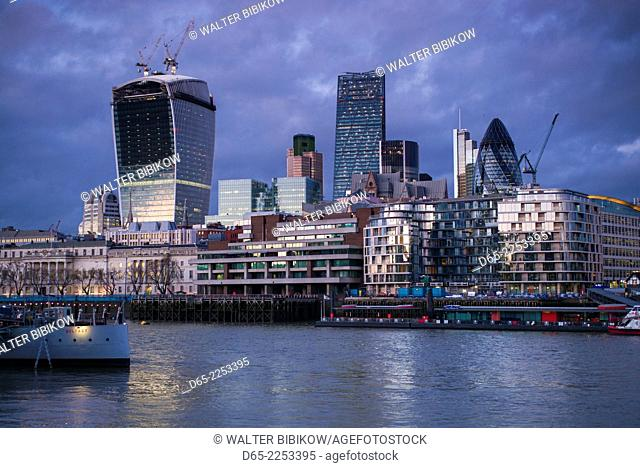 England, London, skyscrapers of The City from the Thames River, dusk