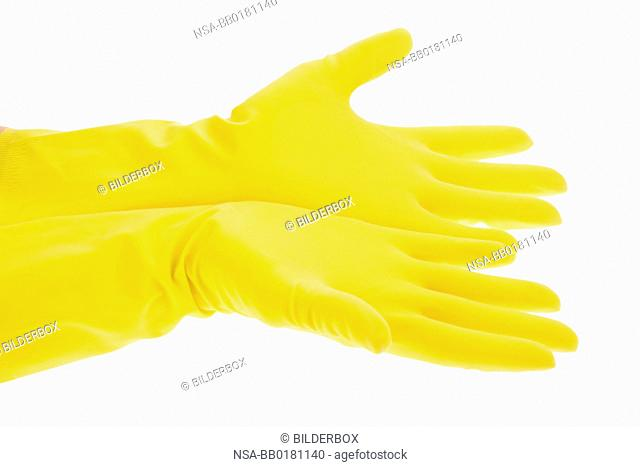 The latex glove of a cleaning lady on a white background