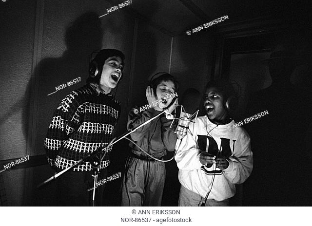 Rinkeby Kids recording in a studio