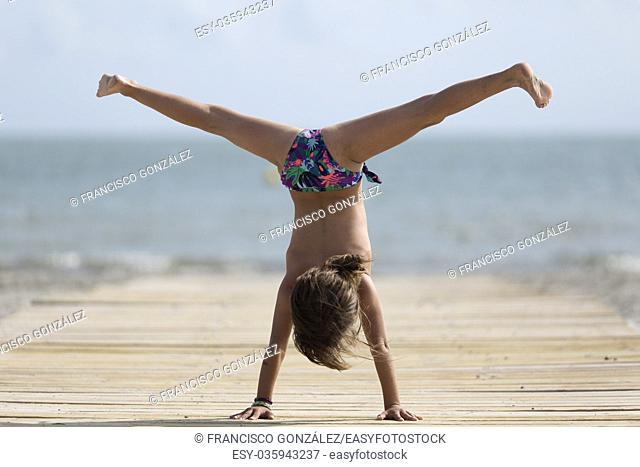 10 year old girl having fun on a beach in Santa Pola, Spain