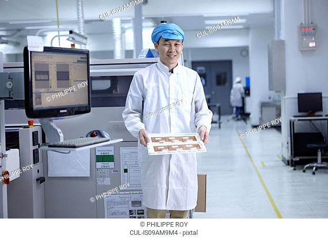 Portrait of worker in factory that specialises in creating functional circuits on flexible surfaces