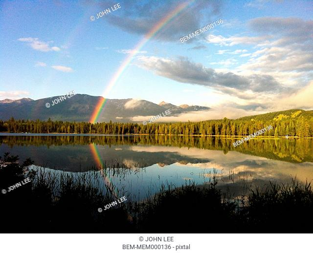 Rainbow over remote lake, Jasper, Alberta, Canada