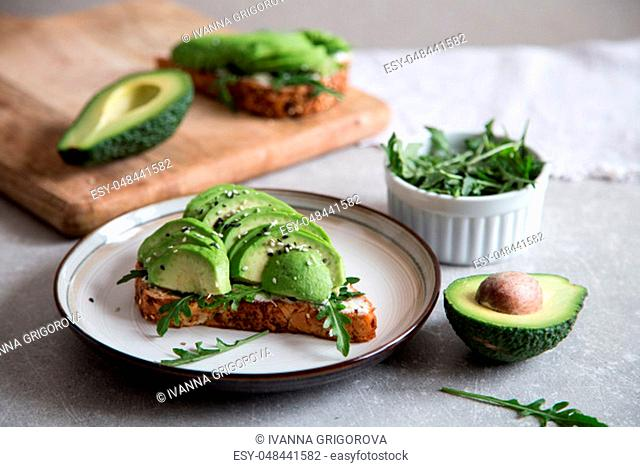 healthy breakfast with avocado and Delicious wholewheat toast. sliced avocado on toast bread with spices. Mexican cuisine/