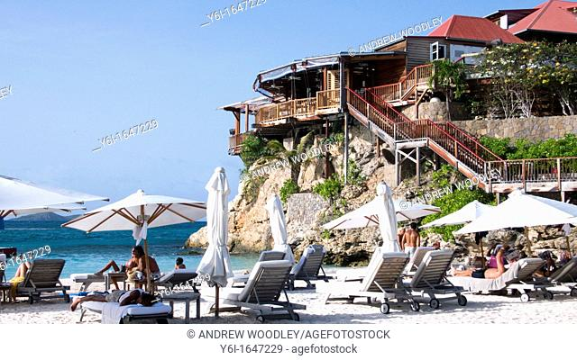 Beach umbrellas and sun loungers beside luxury Eden Rock Hotel Baie de St Jean St Barts
