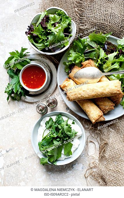 Egg rolls with salad bowls and sweet chilli dipping sauce