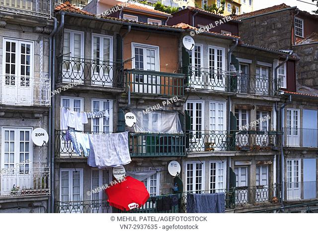 Satellite dishes and balconies in the old town of Porto, Portugal