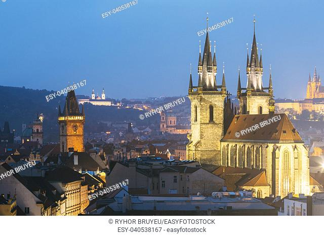 Night cityscape of Prague, Czech Republic. Famous Old town hall, Church Of Our Lady Before Tyn