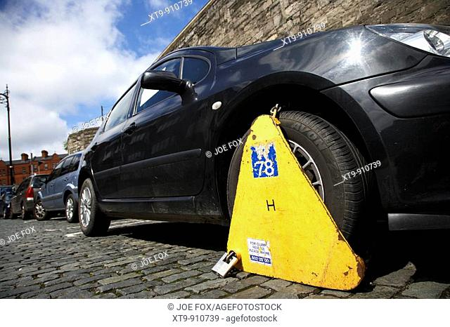 car clamped with wheelclamp in dublin city centre republic of ireland