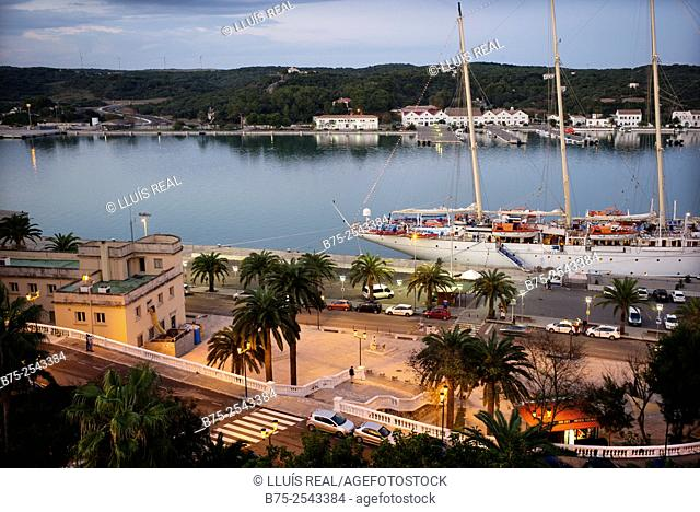 View of Port Mahon, with a classic sailing boat cruise ship moored at the pier. Mahon, Maó, Menorca, Balearic Islands, Spain, Europe