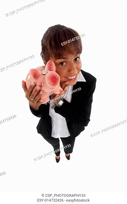 Happy young businesswoman with piggy-bank
