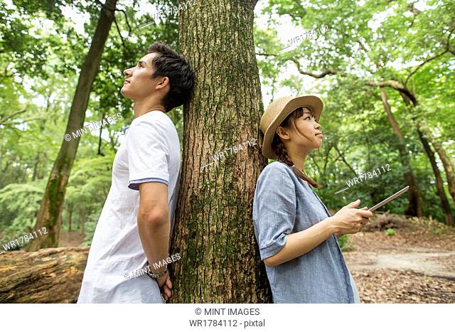 A couple at an outdoor party in a forest
