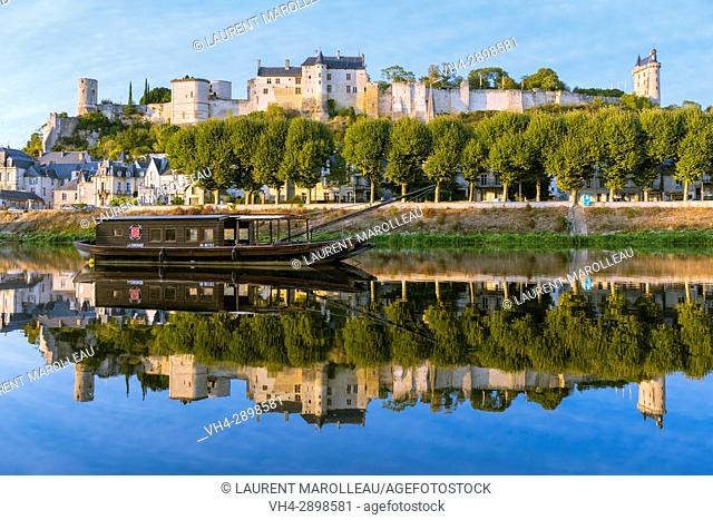 Traditional Flat-Bottom Boat on the banks of Vienne River, the City and the Royal Fortress of Chinon. Indre-et-Loire, Central Region, Loire Valley, France