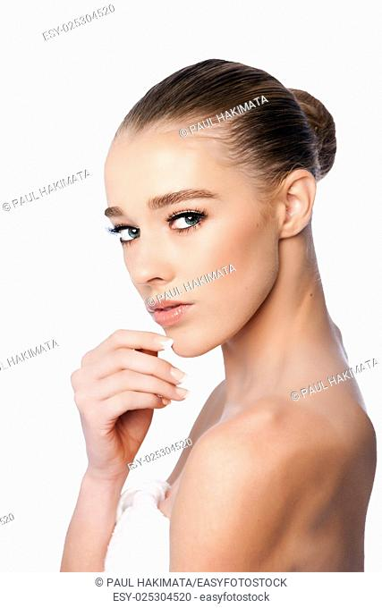 Beautiful clean face of woman from side, aesthetics exfoliating skincare concept, on white