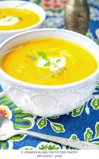 A Close Up of a Bowl of Butternut Squash and Apple Soup