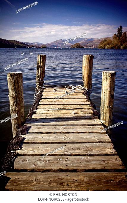England, Cumbria, Windemere, A view down a wooden jetty to Lake Windemere