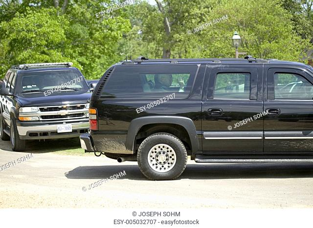 Vice President Dick Cheney waving from back seat of black SUV as he leaves Williamsburg, Virginia, having attended an event with Her Majesty Queen Elizabeth II