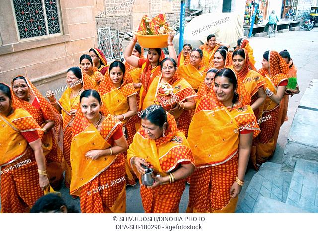 Ladies with ghudala going to pond Gangaur festival Rajasthan India Asia