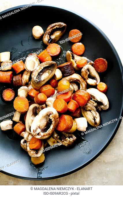 Steamed carrots and mushrooms