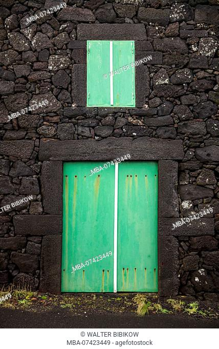 Portugal, Azores, Pico Island, Porto Cachorro, old fishing community set in volcanic rock, buildings