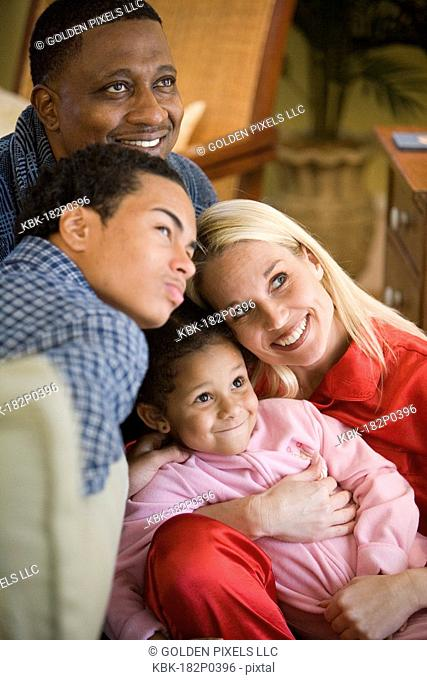 Close-up of an inter-racial family dressed in pajamas