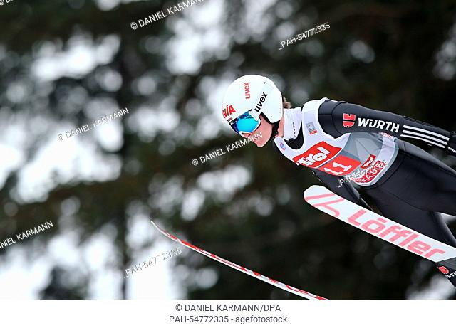 Marinus Kraus of Germany soars through the air during a practice jump for the third stage of the 63rd Four Hills Tournament ski jumping event in Innsbruck