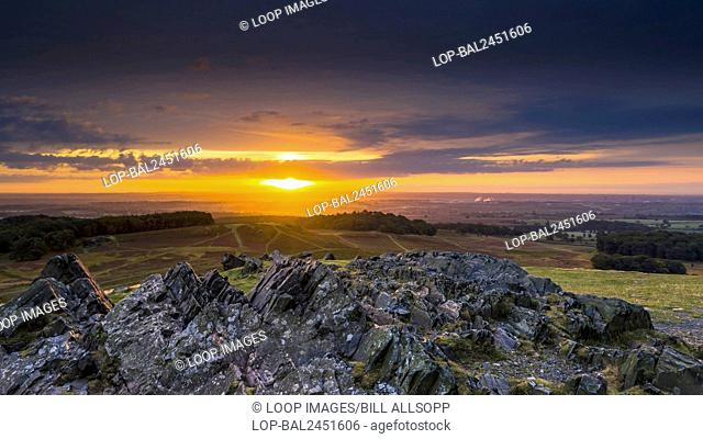 Early morning sun bounces off the Pre Cambian granite outcrops at Bradgate Park in Leicestershire