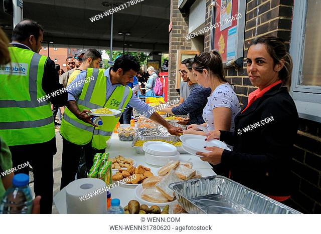 Volunteers and failmy and police at Grenfell Tower in West London Featuring: Atmosphere Where: London, United Kingdom When: 16 Jun 2017 Credit: WENN