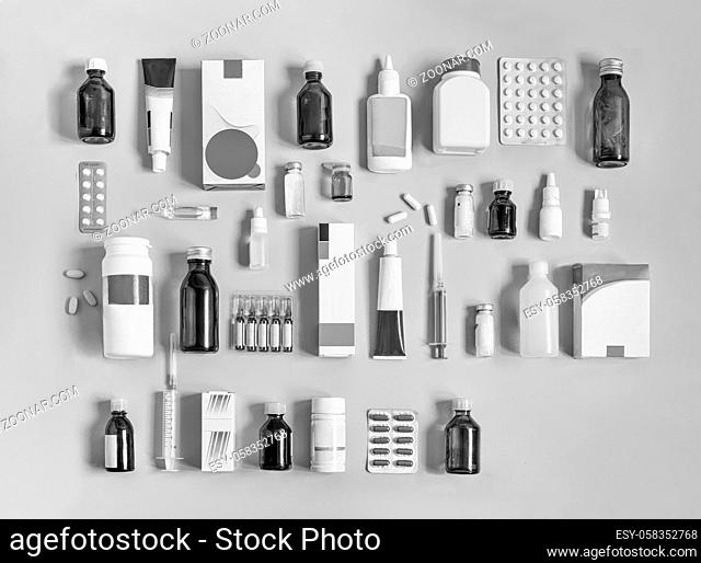 Various forms of drugs: tablets, ampoules, tinctures, blister packaging, black and white image. Place to insert text, top view. Medicine and pharmacy