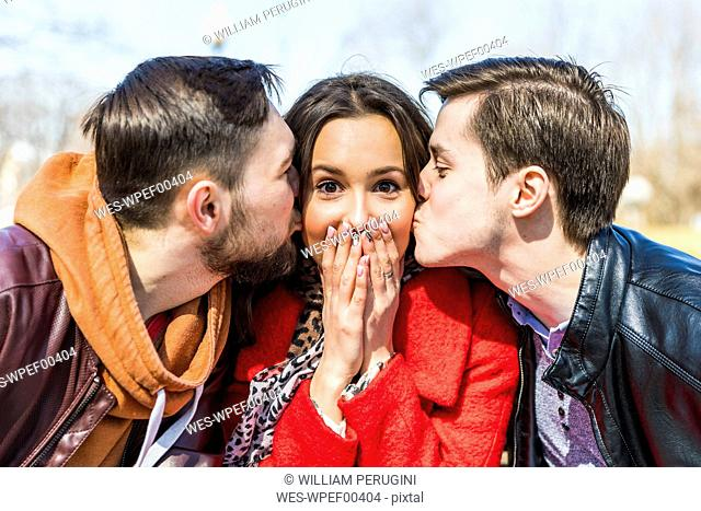 Russia, Moscow, group of friends, young men kissing a young woman