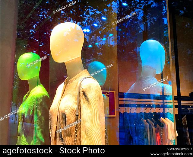 Mannequin and its reflections in a shop window. Madrid, Spain