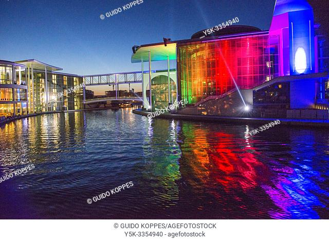 Berlin, Germany. Light show being projected on the exterior wall of the German Bundestag buildings, narrating the history of the countries political...