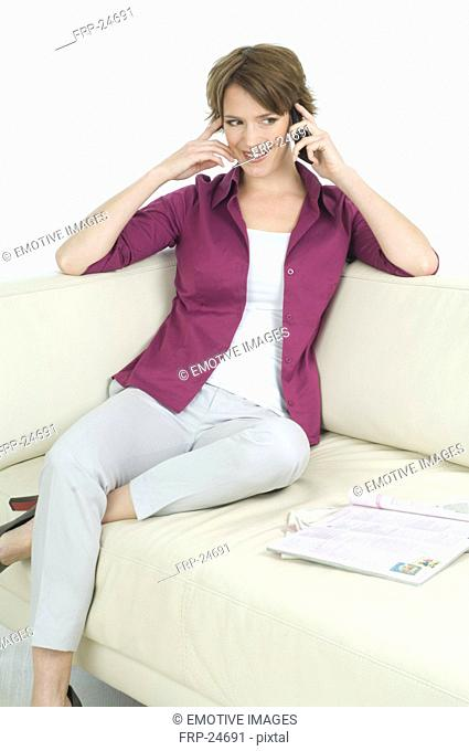 Young woman in casual wear on the telephone