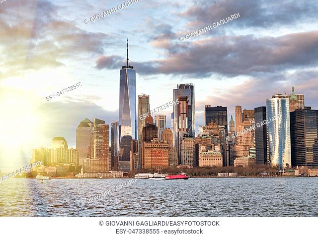Amazing sunset skyline of Lowr Manhattan from a cruise ship, New York City