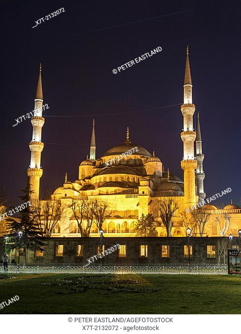 The floodlit domes and minarets of the Sultan Ahmet or Blue Mosque, Sultanahmet, Istanbul, Turkey