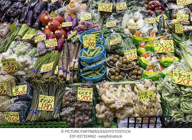 Variety of fresh vegetables and price tags at the Omicho Market
