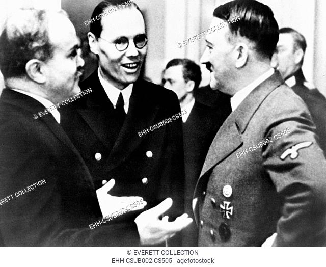 Vyacheslav Molotov speaks to Adolf Hitler and with the aid of an interpreter. Berlin, Dec. 1940. The Soviet Foreign Minister was visited Germany for discussions...